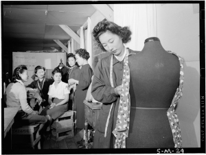 Dressmaking class, Manzanar Relocation Center, California / photograph by Ansel Adams