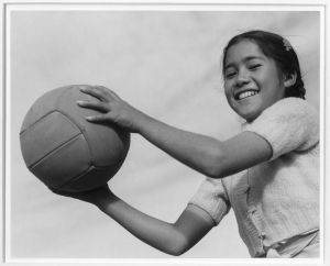 Girl and volley ball, Manzanar Relocation Center, California / photograph by Ansel Adams