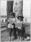 Two small boys holding up their drawings on small blackboards, Nicaragua, ca. 1915