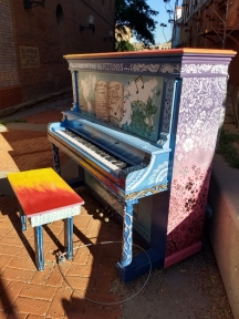 there are numerous pianos on the sidewalks around town